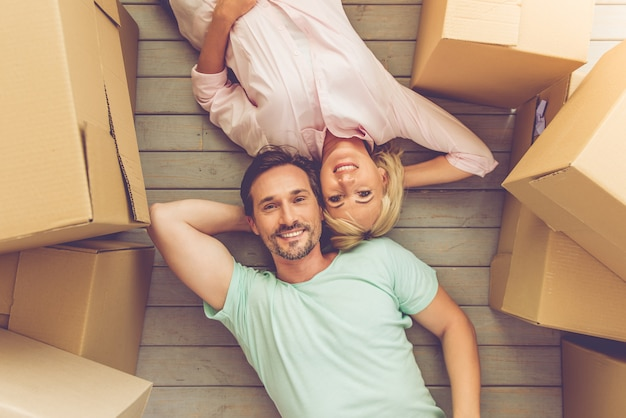 Top view of beautiful mature couple is lying on the floor.