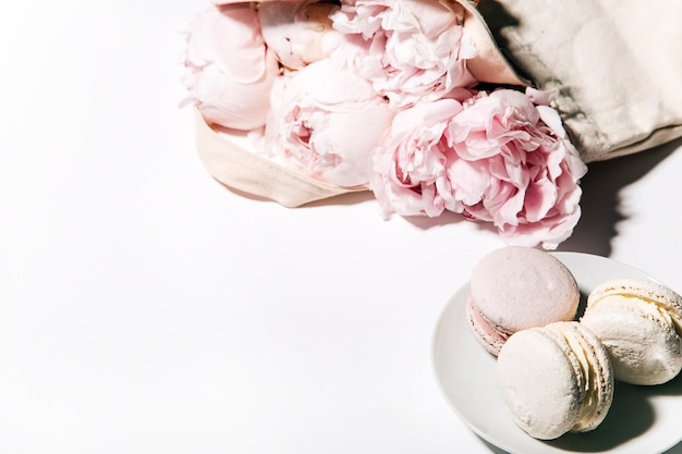 Top view of beautiful pink flowers and sweets