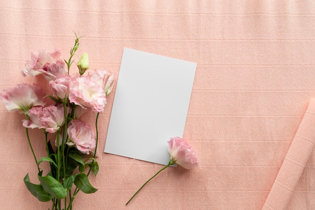 Top view of beautiful roses with blank card