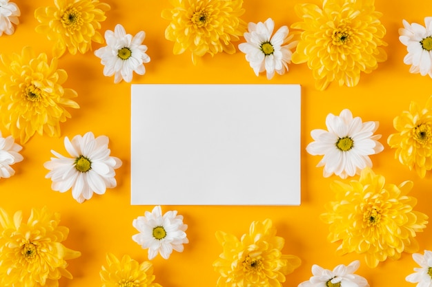 Top view beautiful spring flowers composition with empty card