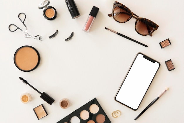Top view beauty cosmetics and mobile