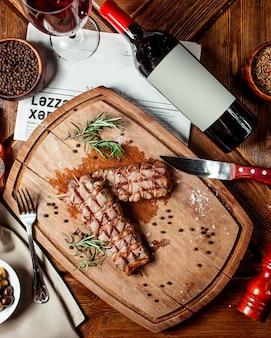 Top view of beef steaks on wood platter