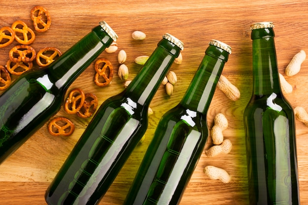 Top view beer bottles with snacks