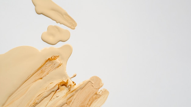 Top view beige foundation with copy space