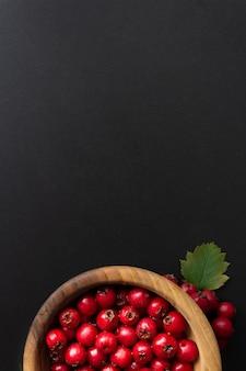 Top view of berries in wooden bowl.