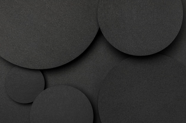 Top view big dots of black paper background