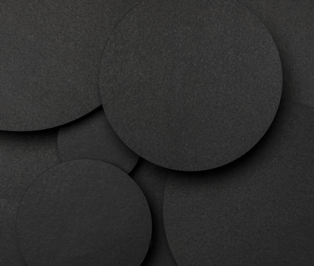 トップビューの黒い紙の背景の大きなドットトップビュー