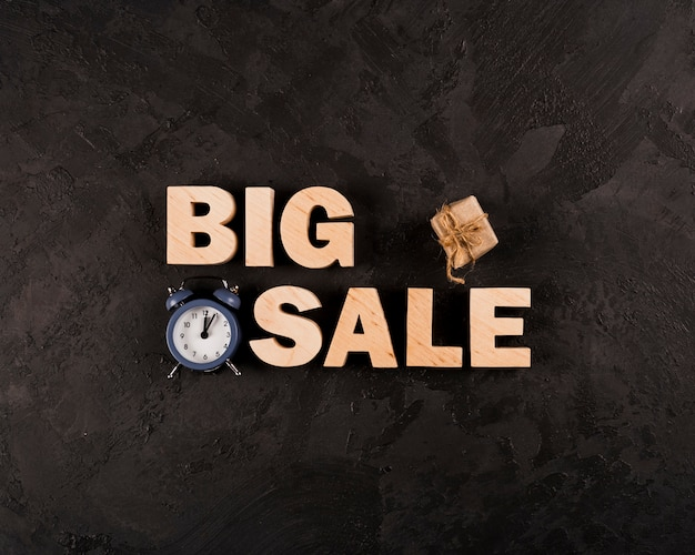 Top view of big sale word on plain background