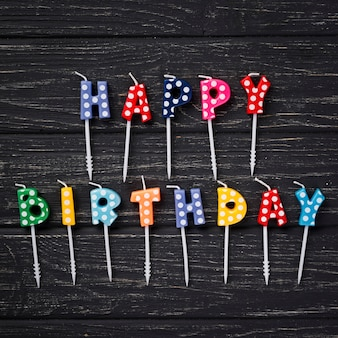 Top view birthday candles on wooden background