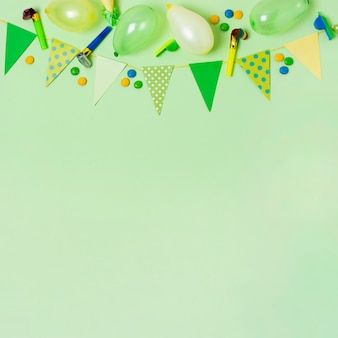 Top view birthday decoration on green background with copy space