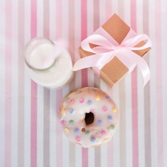 Top view birthday donut with milk and present