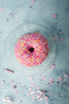 Top view of birthday doughnut with sprinkles