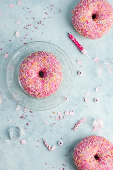 Top view of birthday doughnuts with sprinkles