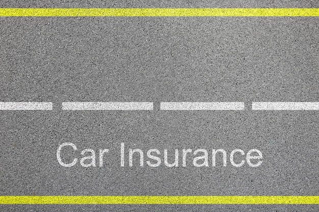 Top view of bitumen road with lanes and car insurance sign concept