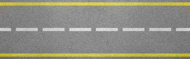 Top view of bitumen road with lanes and limits sign