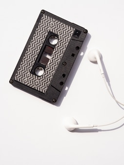 Top view black cassette tape with earphones