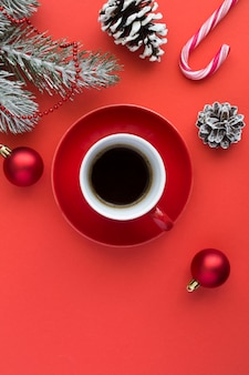Top view of black coffee in the red cup and christmas composition
