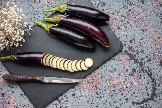 Top view black eggplants on cutting board blue surface food dinner lunch salad color meal tree grow ripe young