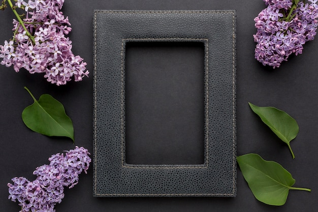 Top view of black frame concept with lilac
