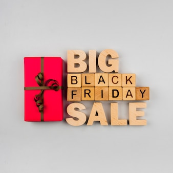 Top view of black friday cubes and present on plain background