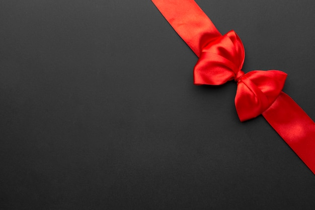 Top view black friday red ribbon with copy space