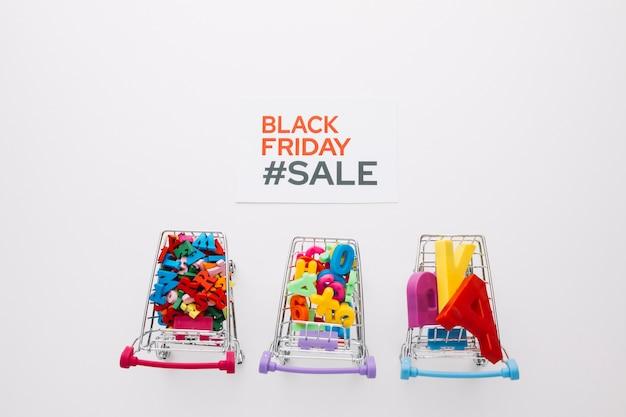Top view black friday shopping carts