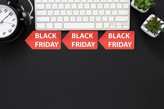 Top view black friday signs below keyboard