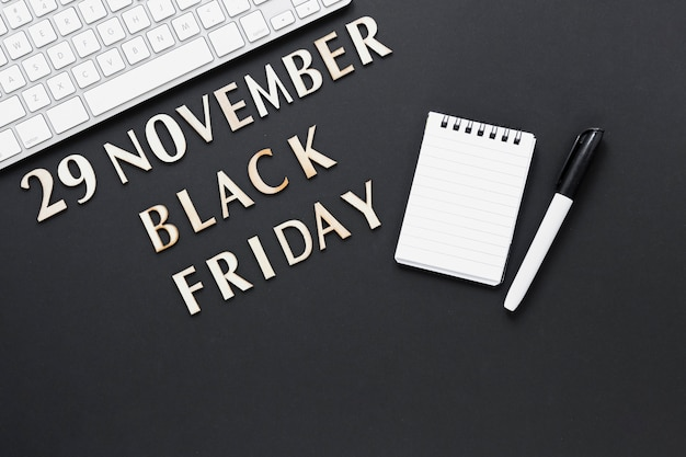Top view black friday text with paper notepad