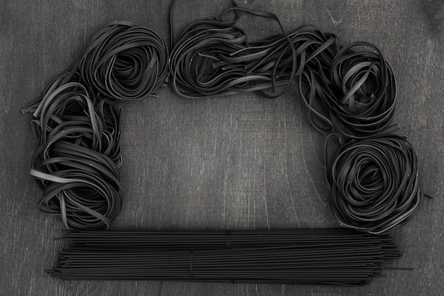 Top view of black spaghetti and tagliatelle
