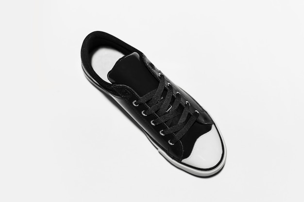 Top view of black vintage shoe on white background.