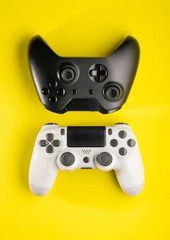 Top view of black and white game controllers
