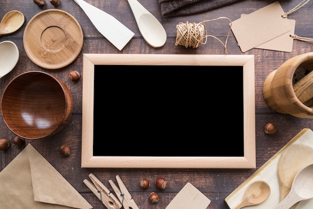 Top view of blackboard menu with wooden spoons and string