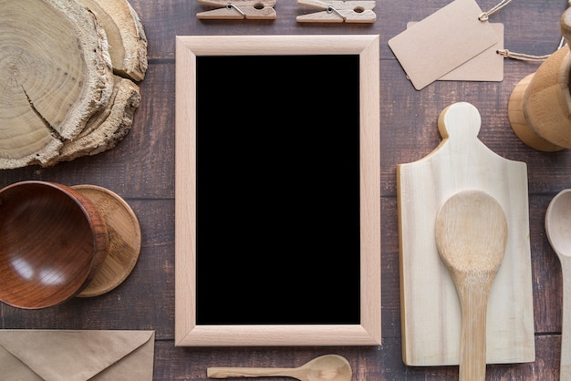 Top view of blackboard menu with wooden spoons