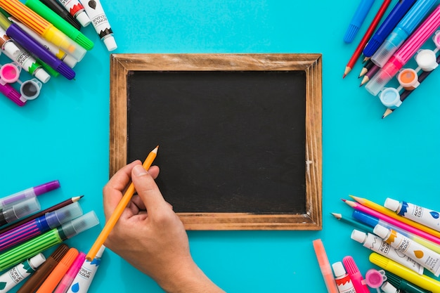 Top view blackboard with painting material corners
