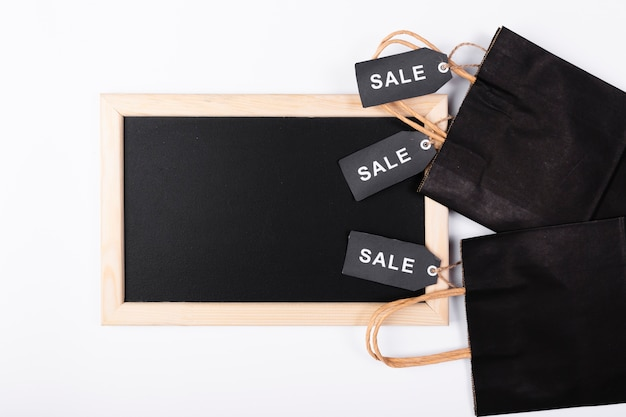 Top view blackboard with shopping bags
