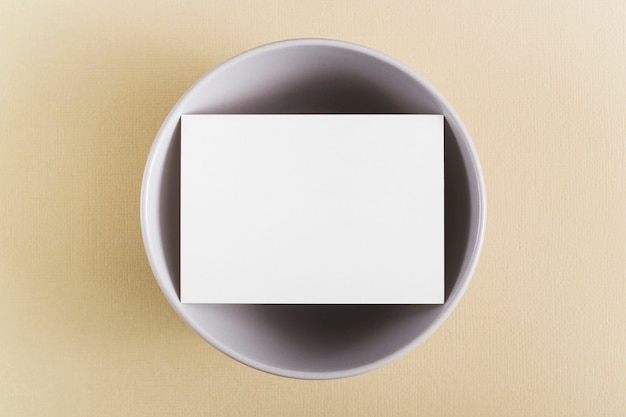 Top view blank business card on a plate