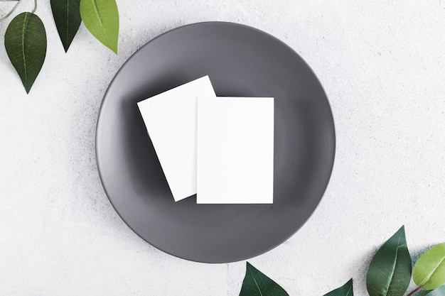 Top view blank business cards on a plate