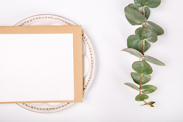 Top view of blank greeting card with plants