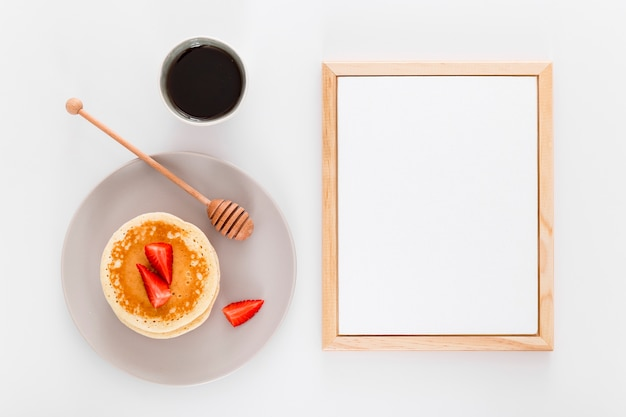 Top view of blank menu paper with honey dipper and dessert
