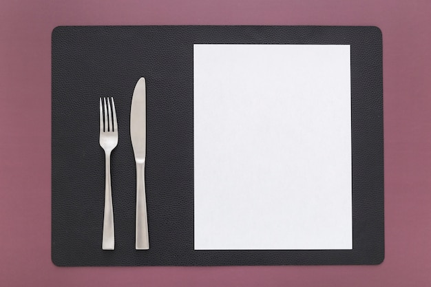 Top view of blank menu paper with knife and fork