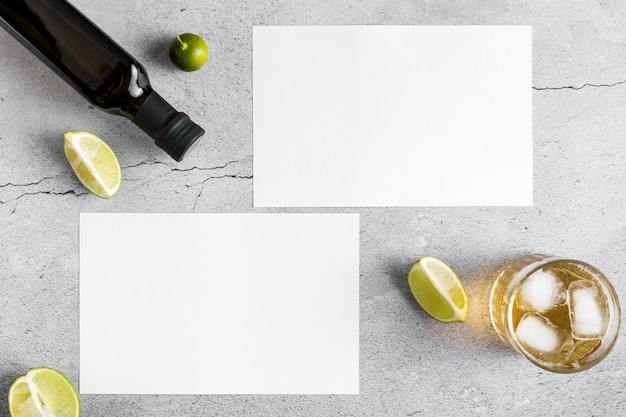 Top view of blank menu papers with olive oil and drink