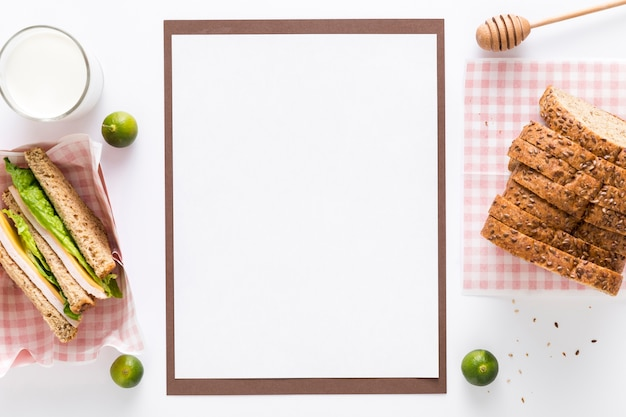 Top view of blank menu with bread and sandwiches