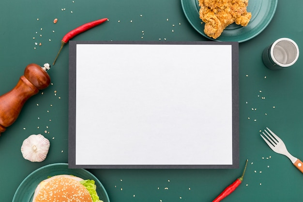 Top view of blank menu with fried chicken and burger