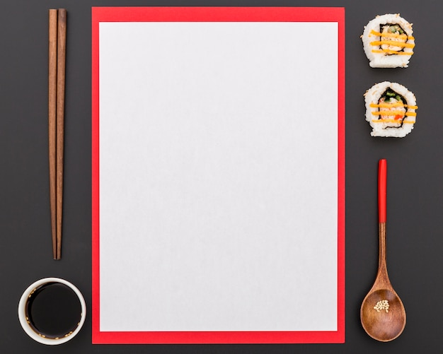 Top view of blank menu with soy sauce and sushi