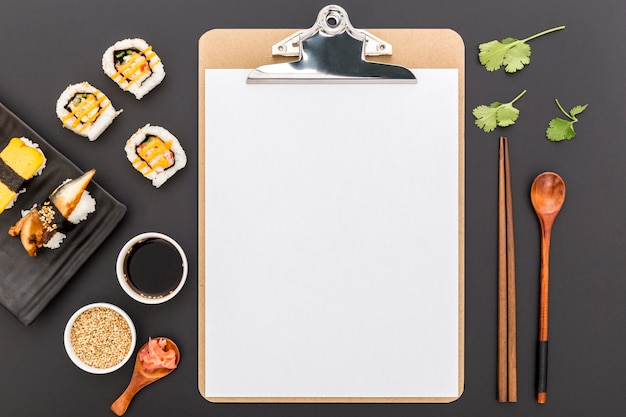 Top view of blank menu with sushi and soy sauce