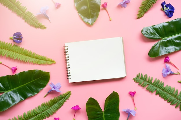 Top view of blank note book on pink background.