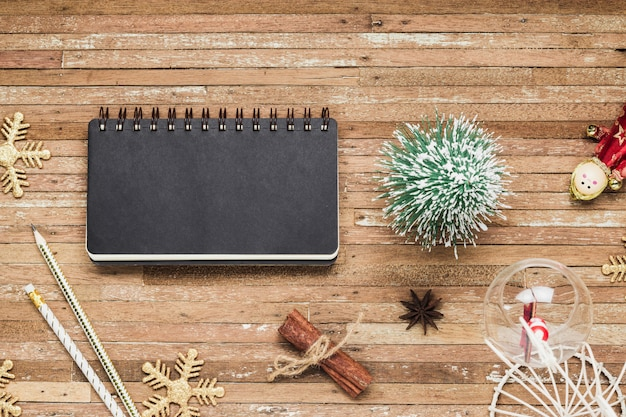 Top view of blank notebook on grunge wood  background with christmas decorations