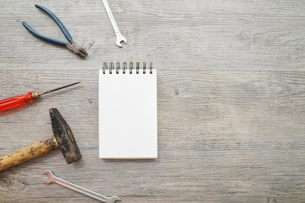 Top view of blank notebook and tools