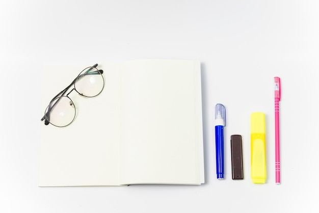 Top view blank notebook with glasses notebook and side calculator
