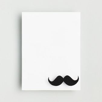 Top view blank paper with moustache
